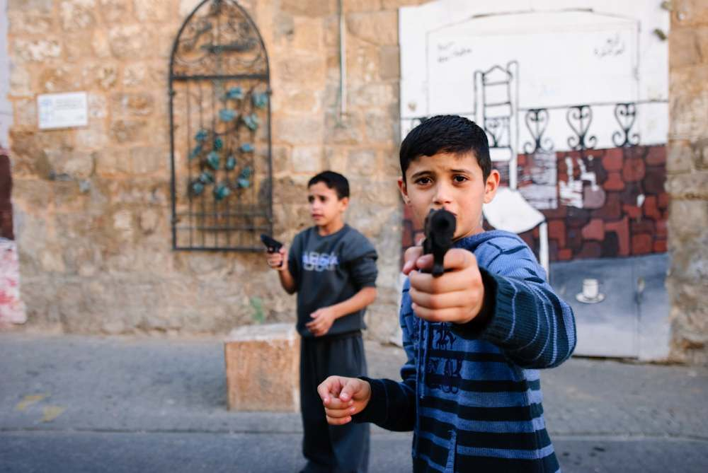 Kids Play with Guns by Dror Miler